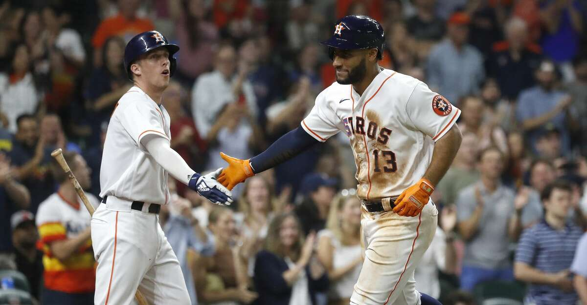 Houston Astros Abraham Toro (13) celebrates his two-run home run with Myles Straw (3) during the seventh inning of an MLB baseball game at Minute Maid Park, Thursday, June 17, 2021.
