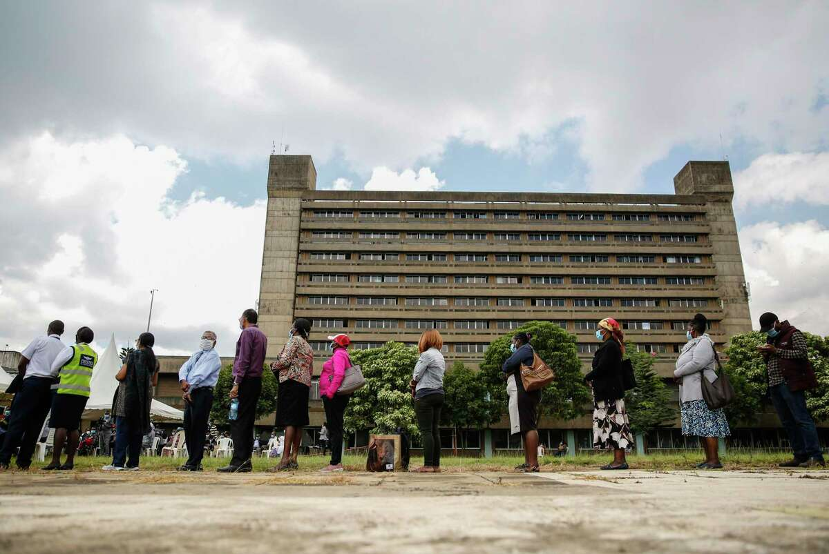 Kenyans line up to receive a dose of the AstraZeneca COVID-19 vaccine manufactured by the Serum Institute of India and provided through the global COVAX initiative, at Kenyatta National Hospital in Nairobi.