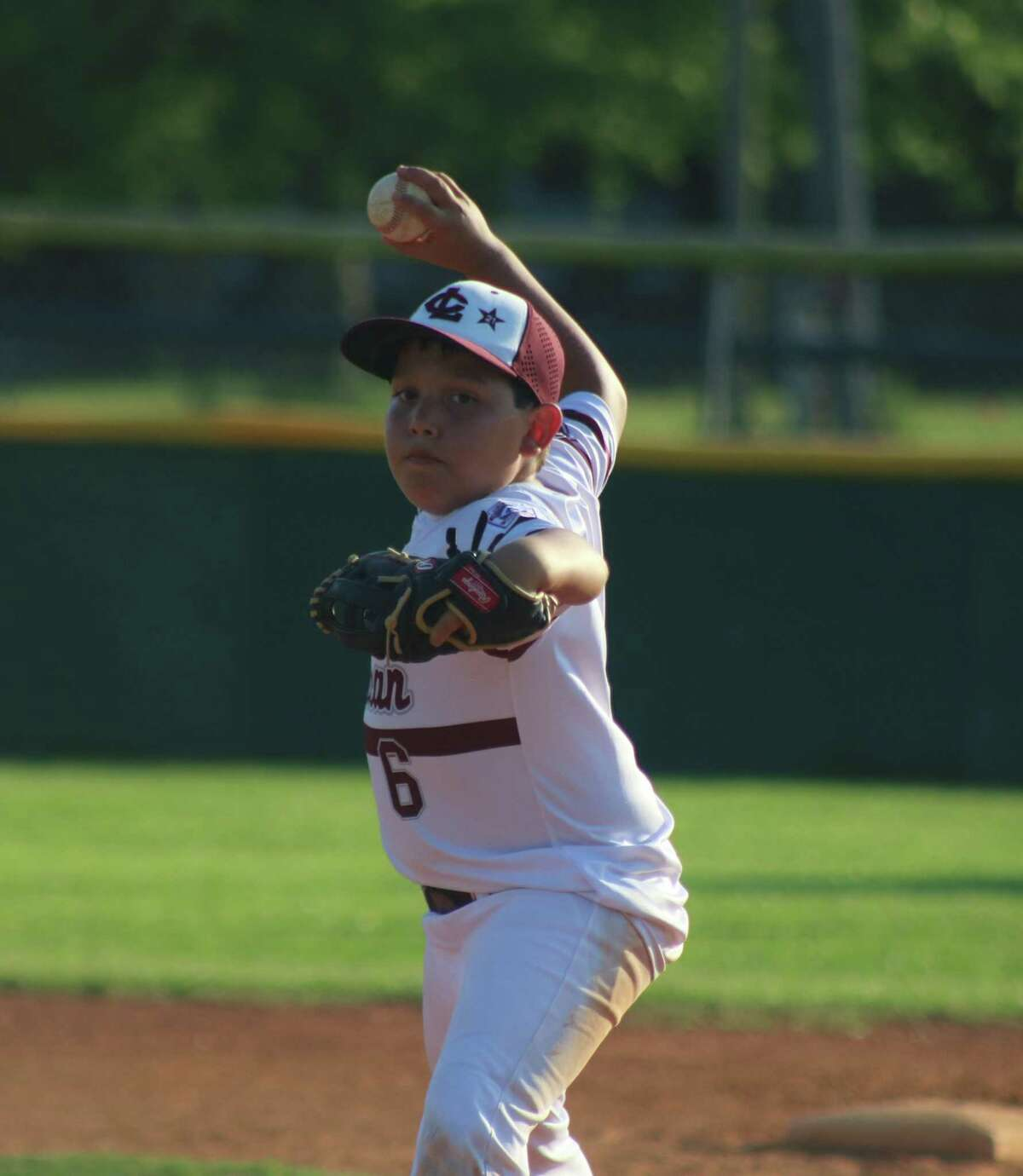 League City American 10s pitcher Andrew Gonzalez concentrates on a batter during Thursday night's District 14 contest in Santa Fe.