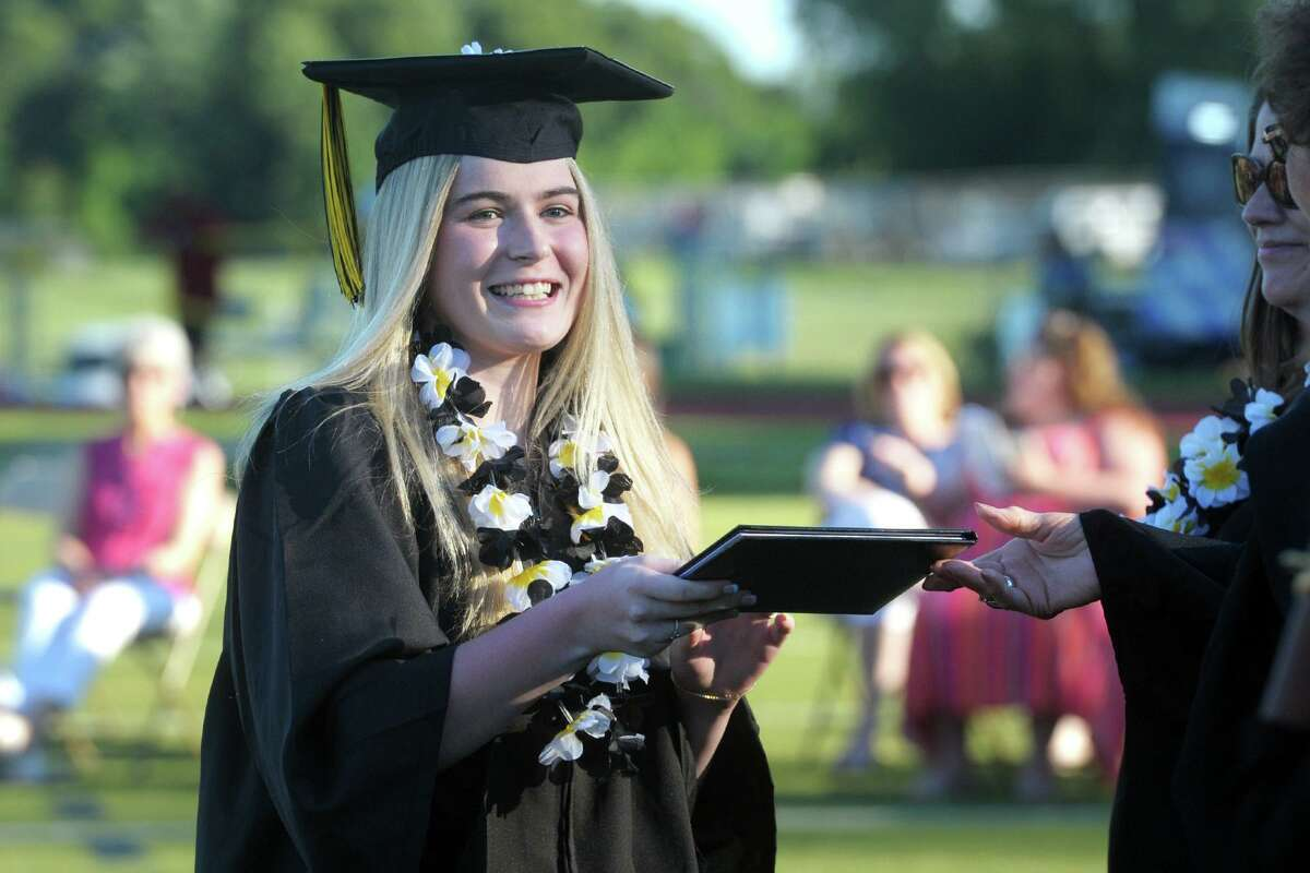 Carley Capuano receives her diploma during graduation on Thursday.