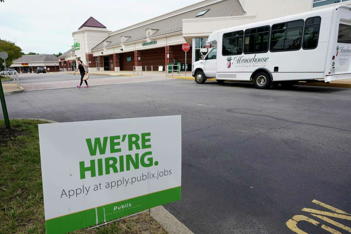 A We're Hiring sign at a Publix supermarket in Richmond, Va., Wednesday, June 2, 2021.
