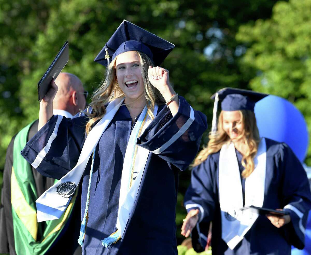 Rachel Varsano cheers as she receives her diploma from Staples High School in Westport, Thursday, June 17, 2021.