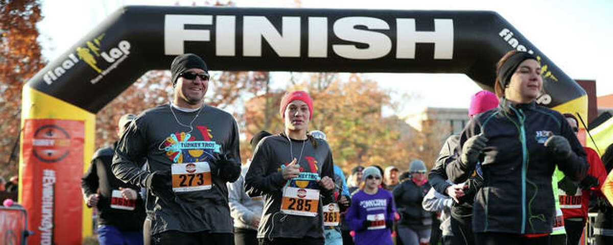 Runners cross the finish line during the Turkey Trot 5K in 2017. The race, which is presented by Edwardsville Neighbors, was held as a virtual event in 2020 but will return to an in-person format on Nov. 25 at Southern Illinois University Edwardsville.