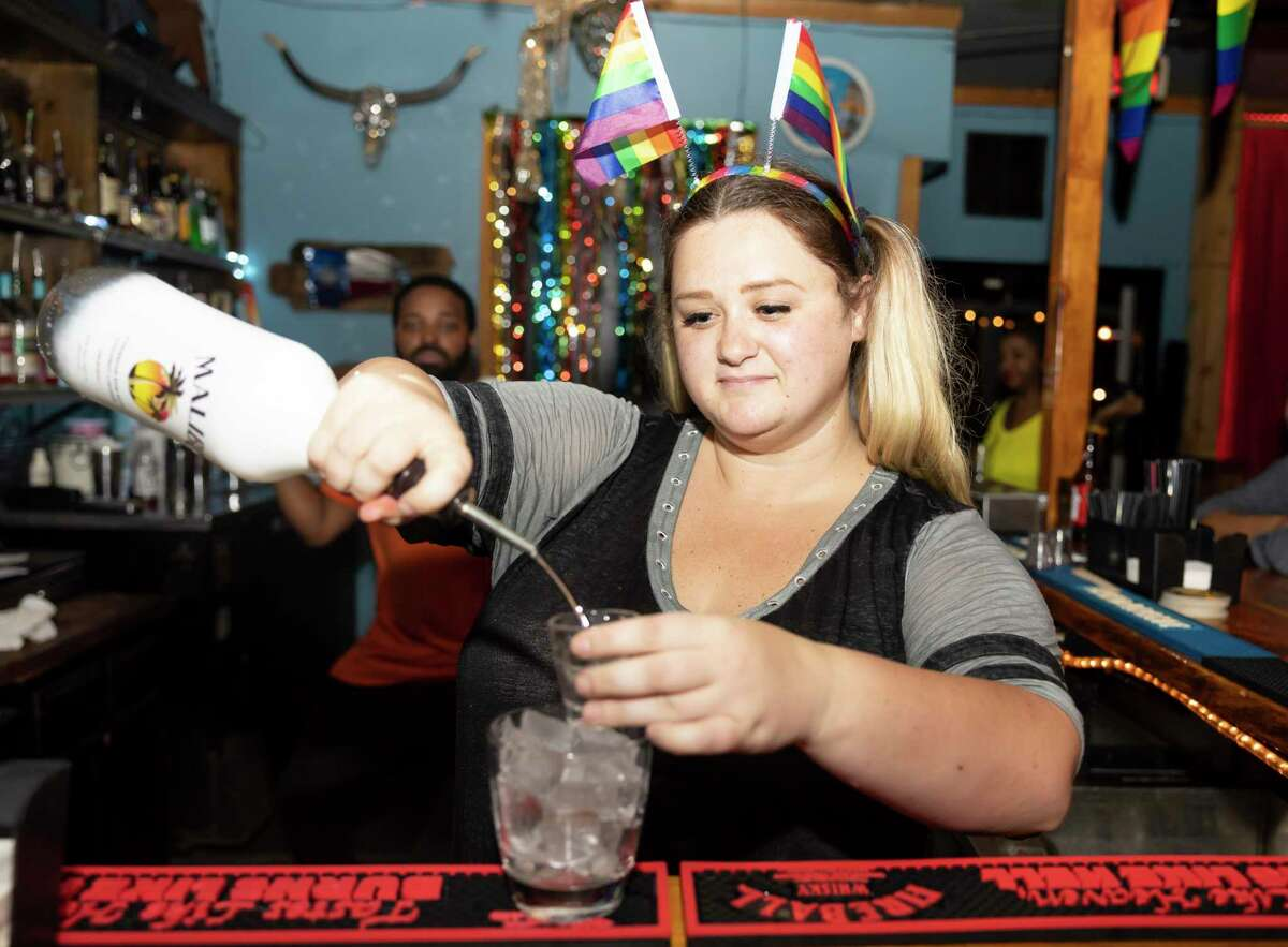Emily Nelson mixes a drink at the Ranch Hill Saloon, Saturday, June 5, 2021, in Spring. The bar will feature a variety of events for this year's pride season.