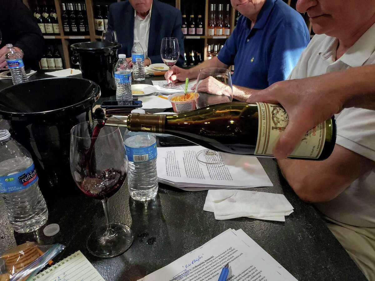 Pouring Beaujolais for a tasting of summer reds at DB Fine Wines in New Canaan.