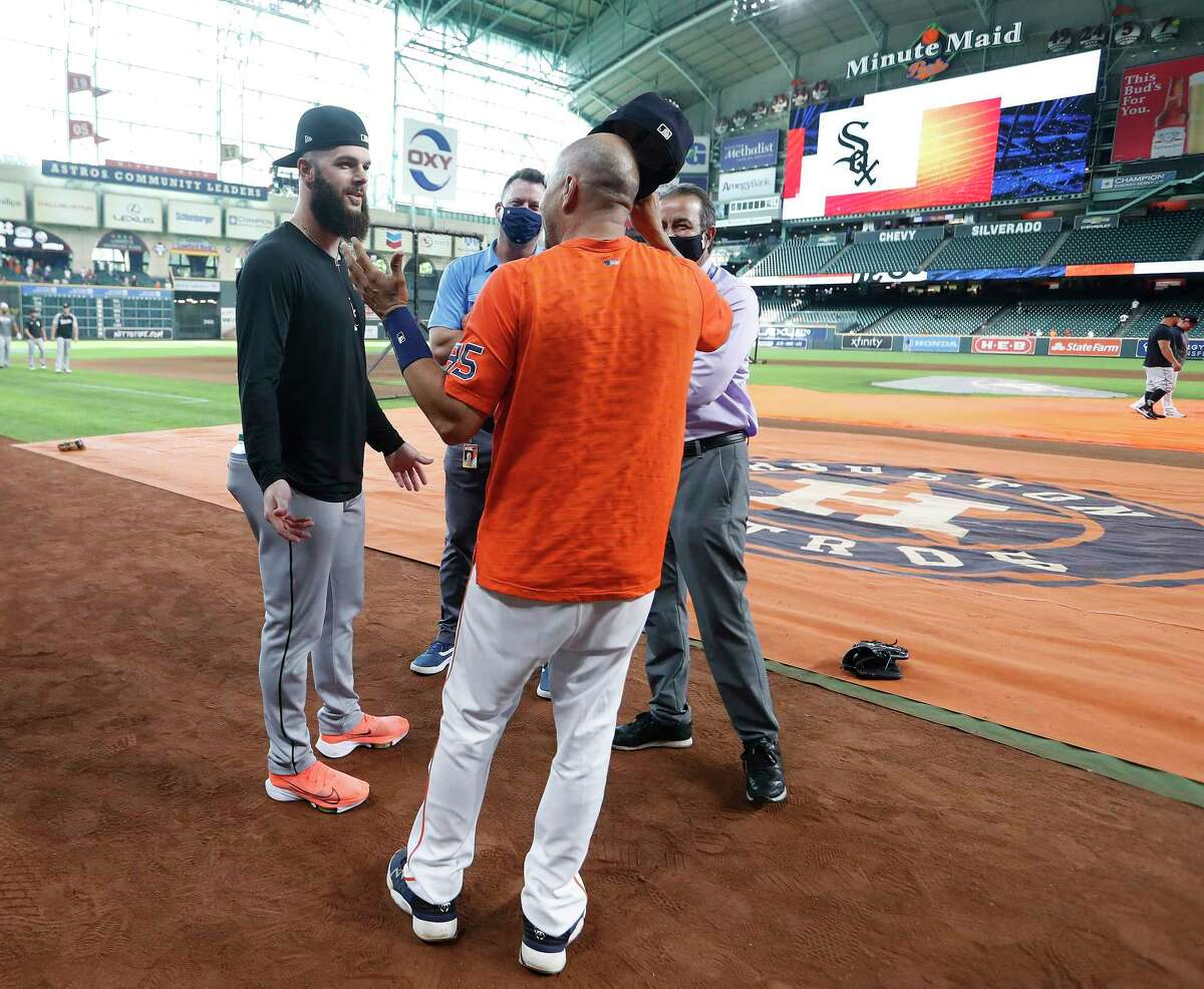 Chicago White Sox pitcher Dallas Keuchel chats with Geoff Blum during batting practice before the start of an MLB baseball game at Minute Maid Park, Thursday, June 17, 2021.