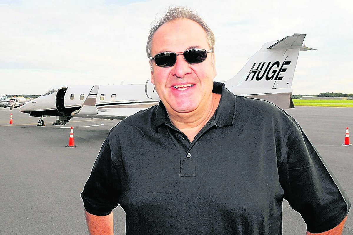 Auto dealer Billy Fuccillo stands in front of his corporate jet at the Albany International Airport in Colonie, New York September 16, 2008.