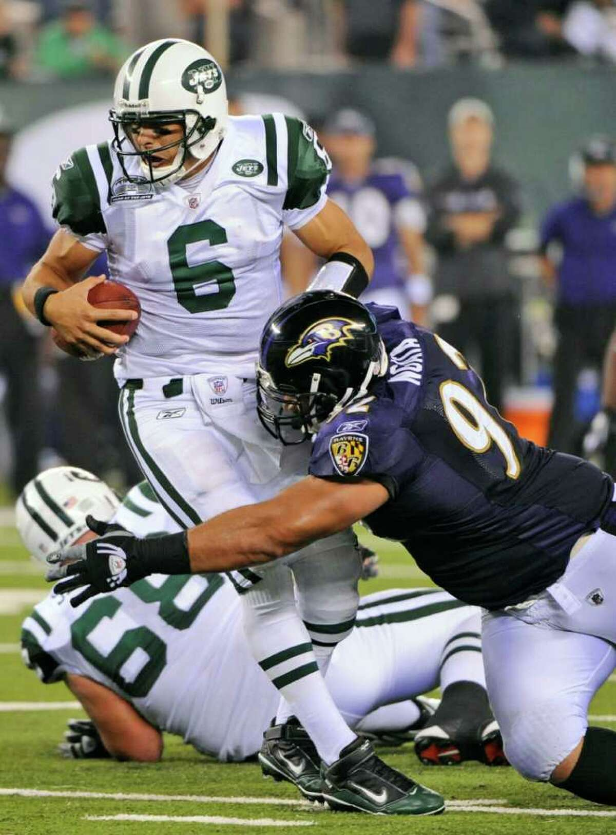 Baltimore Ravens defensive tackle Haloti Ngata (92) sacks New York Jets quarterback Mark Sanchez (6) during the fourth quarter of an NFL football game at New Meadowlands Stadium in East Rutherford, N.J., Monday, Sept. 13, 2010. The Ravens won 10-9. (AP Photo/Bill Kostroun)
