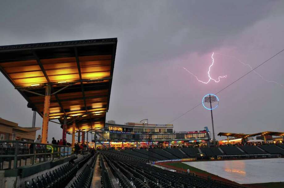 Lightning over MCU Park in Brooklyn preceded a heavy rain that postponed Monday night's Tri-City ValleyCats game against the Brooklyn Cyclones. The best-of-3 championship series will continue on Tuesday. (Philip Kamrass / Times Union) Photo: Philip Kamrass