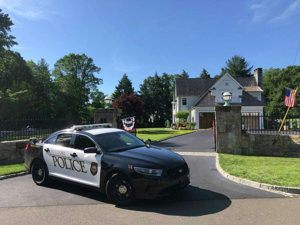A police cruiser on Friday parked in front of the Westport, Conn., home where a woman and a 7-year-old were found dead on Thursday, June 17, 2021.