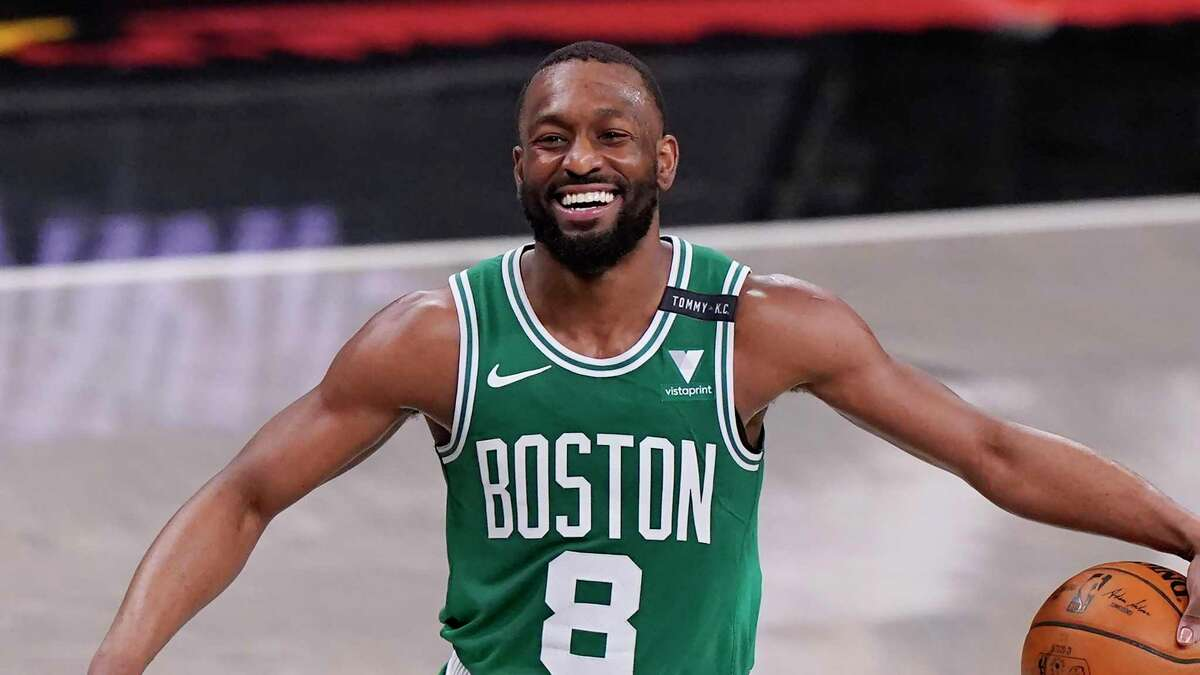 Boston Celtics guard Kemba Walker (8) laughs as he takes the ball up court during the second quarter of Game 2 of an NBA basketball first-round playoff series against the Brooklyn Nets, Tuesday, May 25, 2021, in New York. (AP Photo/Kathy Willens)