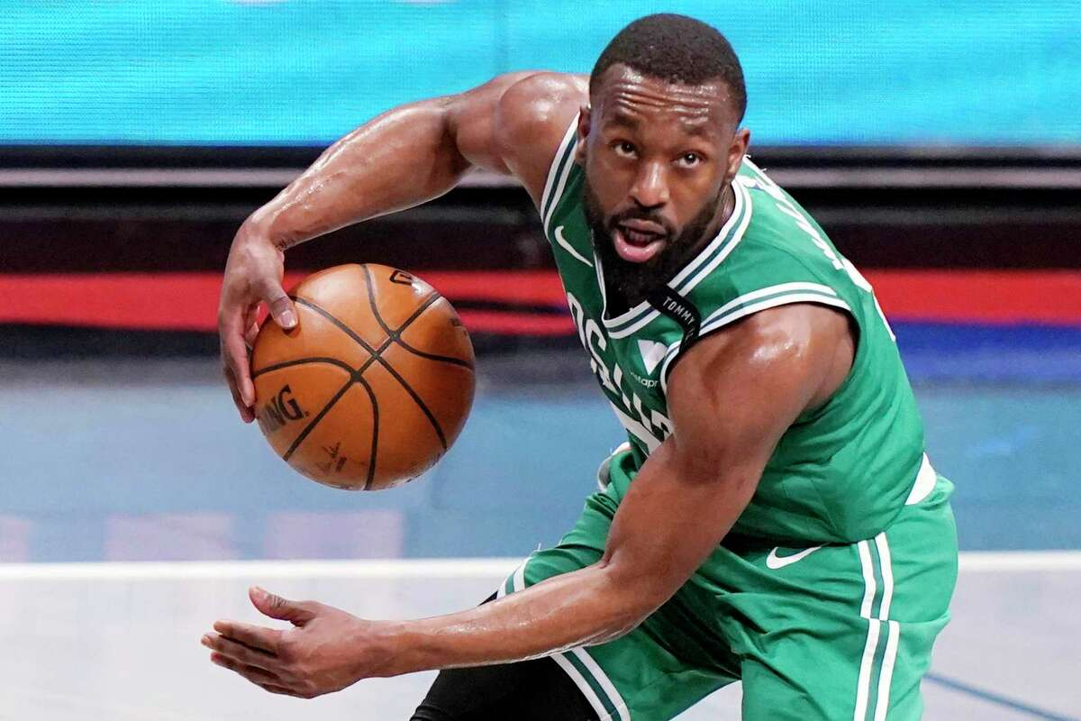 FILE - In this May 25, 2021, file photo, Boston Celtics guard Kemba Walker (8) looks for an outlet during the first quarter of Game 2 of an NBA basketball first-round playoff series against the Brooklyn Nets in New York. The Celtics traded Walker to Oklahoma City for forward Al Horford, a person with knowledge of the deal told The Associated Press on Friday, June 18, 2021. (AP Photo/Kathy Willens, File)
