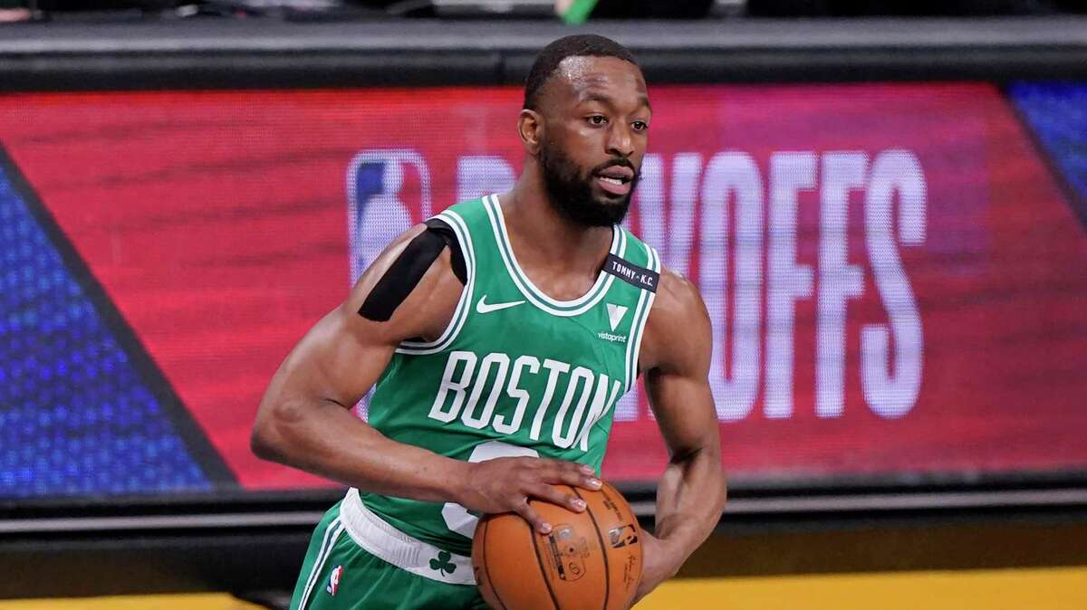 Boston Celtics guard Kemba Walker (8) looks to pass during the first quarter of Game 2 of an NBA basketball first-round playoff series against the Brooklyn Nets, Tuesday, May 25, 2021, in New York. (AP Photo/Kathy Willens)