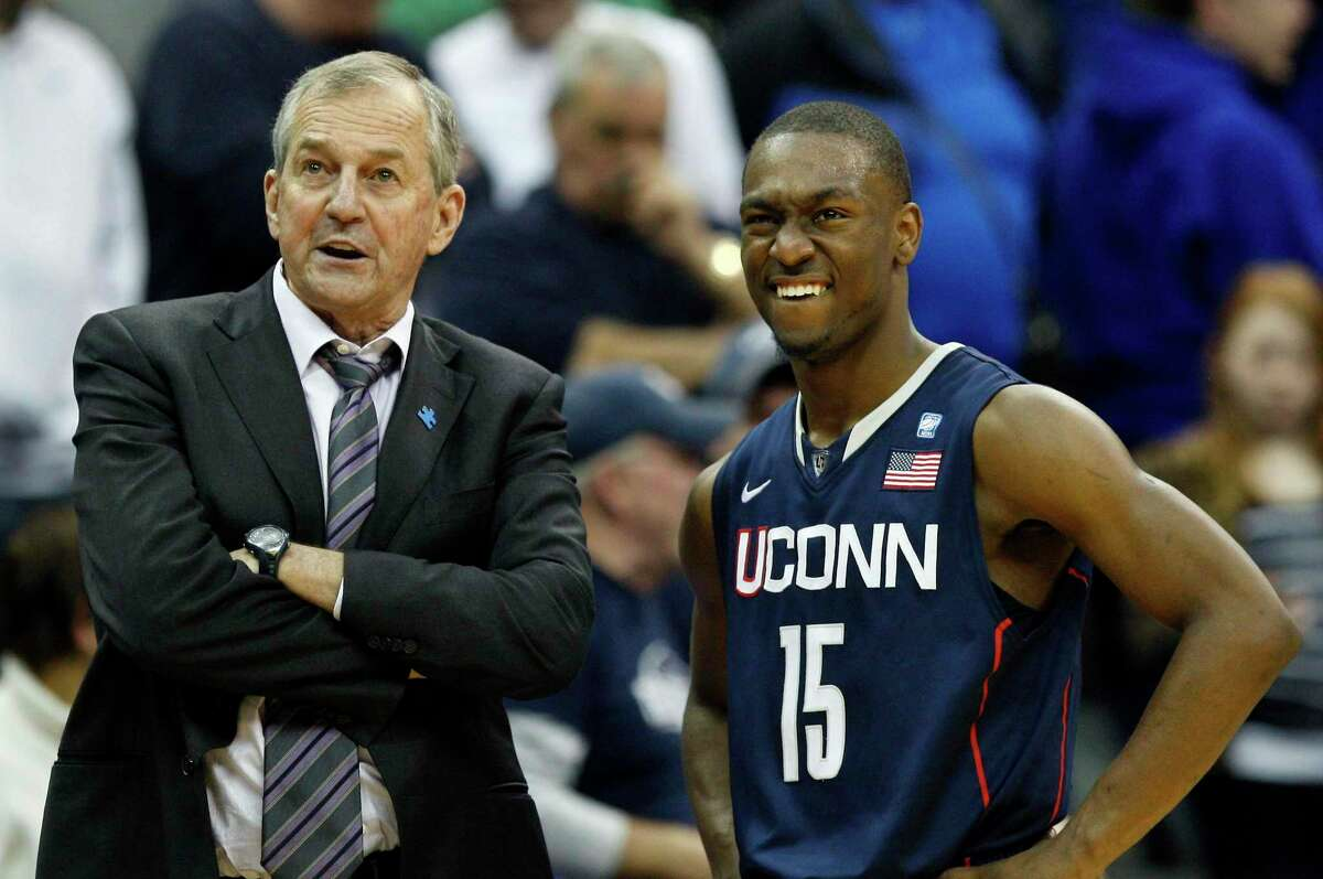 In this Feb. 5, 2011, file photo, Connecticut head coach Jim Calhoun, left, stands with player Kemba Walker (15) near the end of the second half of an NCAA college basketball game against Seton Hall in Newark, N.J. With do-everything guard Kemba Walker taking the reins, the Huskies raced past all expectations by beating some of the nation's best programs to win the Maui Invitational in November. That jumped UConn not just back into the polls, but the Top 10(AP Photo/Mel Evans, File)
