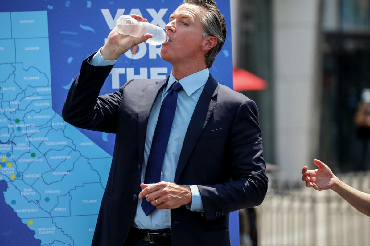 Gov. Gavin Newsom drinks some water at Universal Studios on Tuesday, June 15, 2021 during the final cash prize drawing in the state's Vax for the Win program.