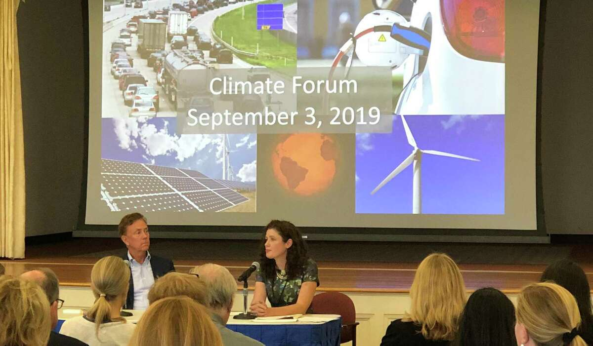 Katie Dykes speaks at a September 2019 forum in Hartford on climate change, alongside Gov. Ned Lamont. Under a Connecticut General Assembly law signed by Lamont, the Connecticut Department of Energy and Environmental Protection will issue a study on whether the state should mandate minimum recycled content for product containers sold in Connecticut. (Press photo via office of Gov. Ned Lamont)