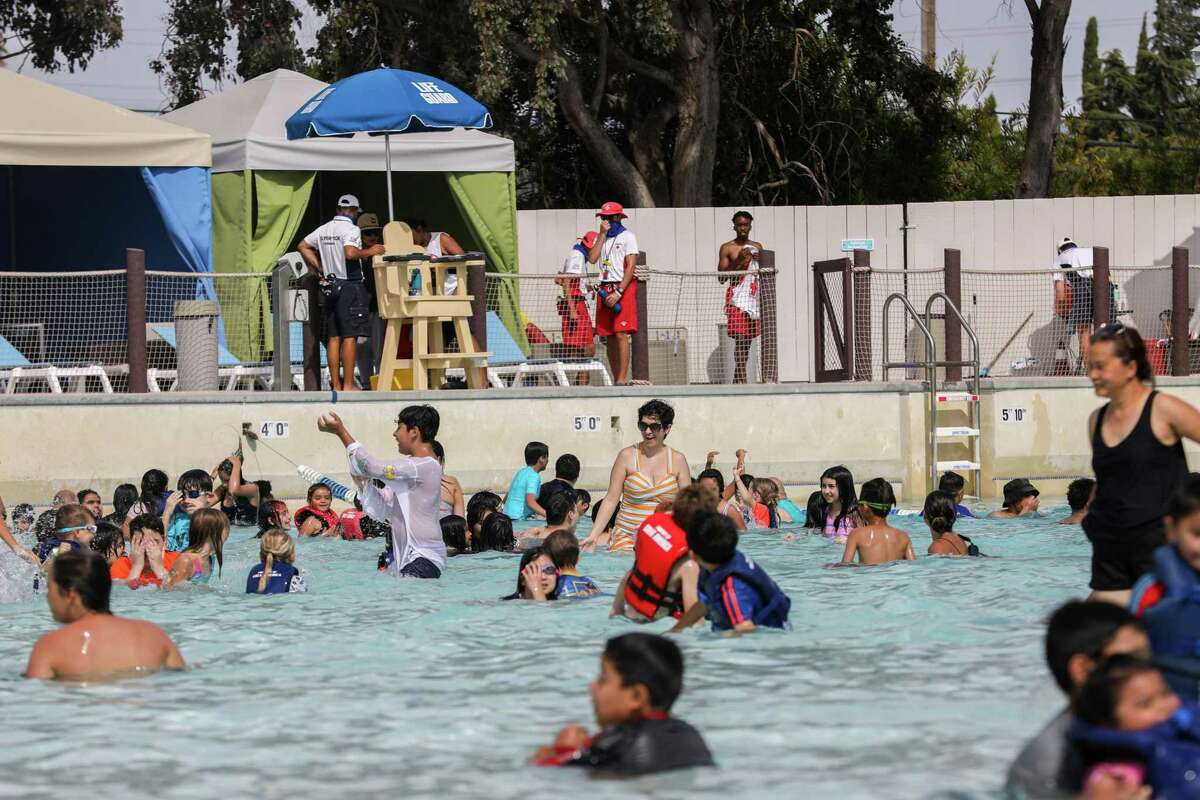 Visitors swim in South Bay Shores water park in Santa Clara in June. California has experienced a rash of record-setting months over the past year, a trend shared by much of the West Coast.