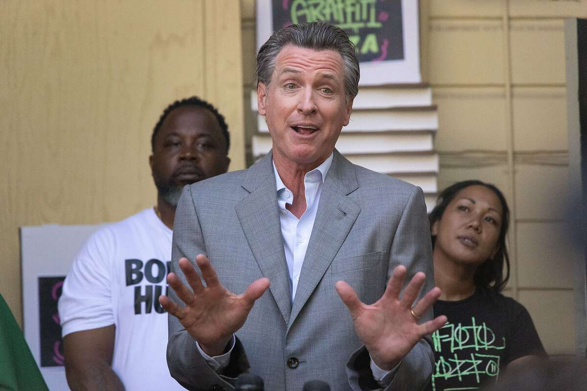 Governor Gavin Newsom Speaks at a press conference in the backyard patio of Graffiti Pizza on Thursday, June 17, 2021 in Oakland, Calif. A 54-year-old Berkeley man was arrested for allegedly assaulting Newsom Thursday while the governor was in Oakland to promote California's reopening.