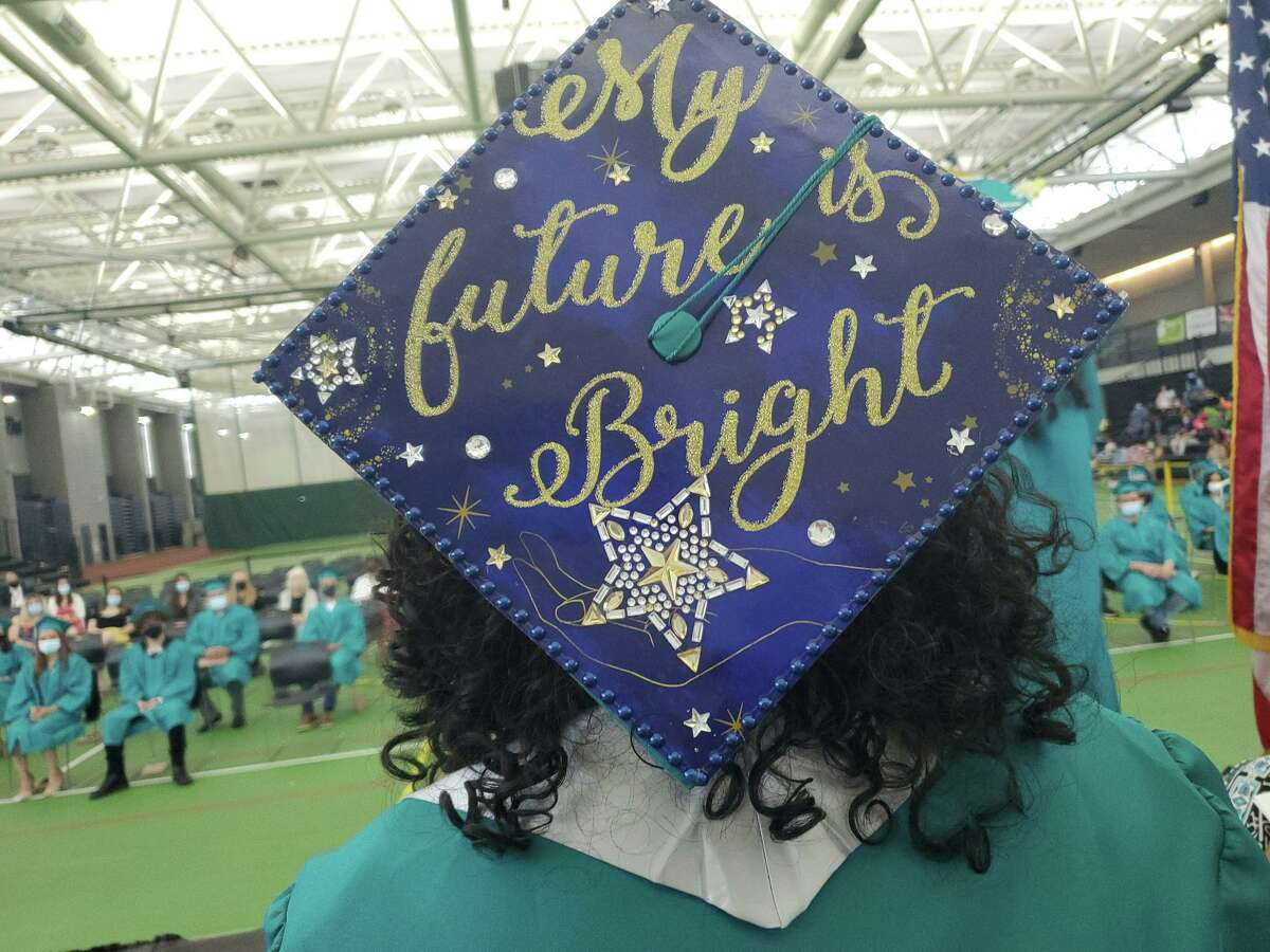 Scenes from commencement exercises for High School in the Community in New Haven Tuesday.