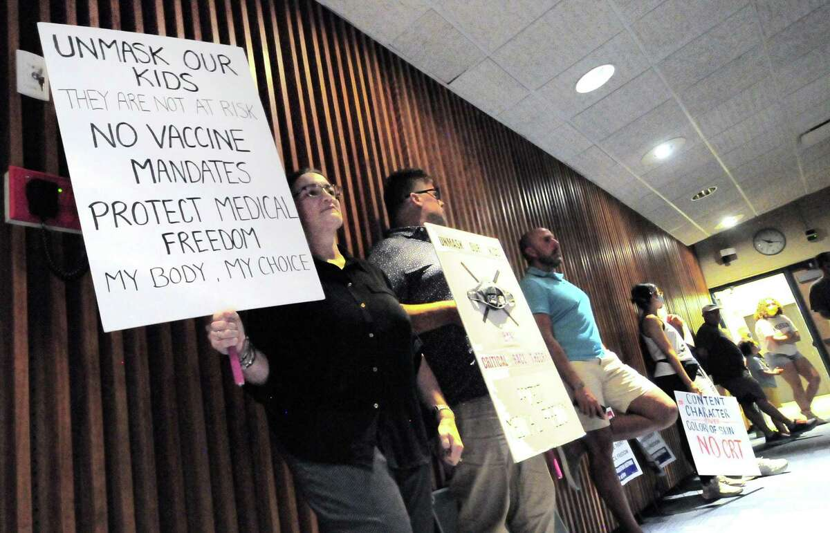 Some Greenwich parents attend a Board of Education meeting at Central Middle School in Greenwich, Conn., on Thursday June 17, 2021, to protest masking and vaccinations for students and the alleged teaching of critical race theory.