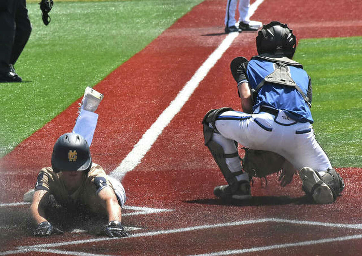Father McGivney's Nathan Terhaar slides in safely across home plate in the fifth inning against Newark in the Class 1A state semifinals at Illinois State University in Normal.