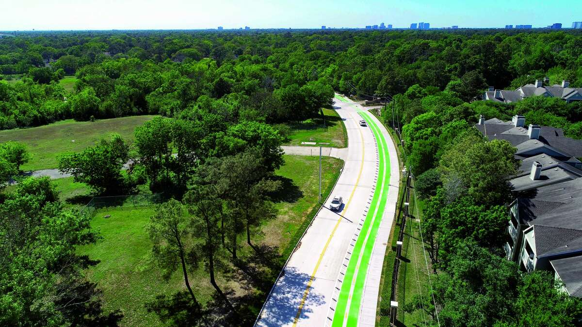 An aerial view shows the new pedestrian route and two-way bike lane on Deerwood Road that Westchase District reconstructed to improve the connection to the Terry Hershey Trail.