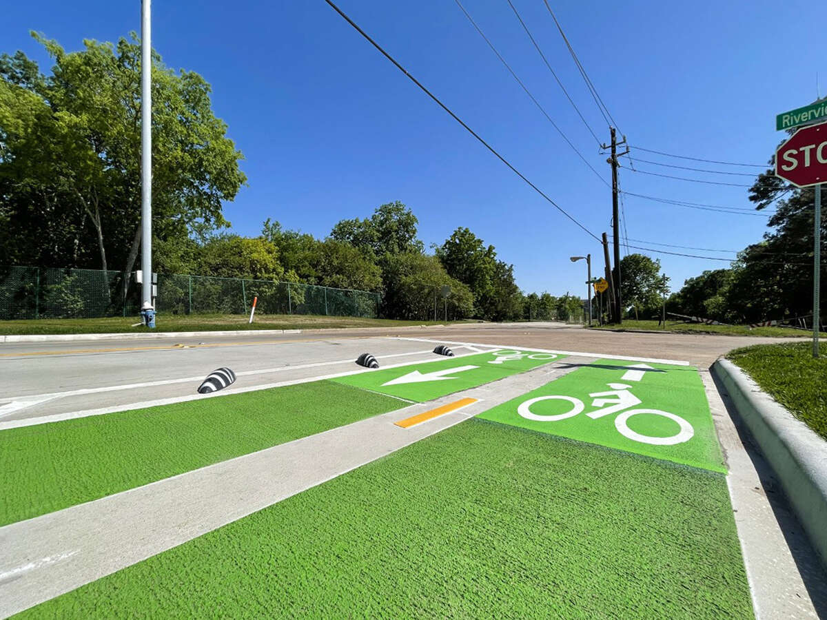 Newly painted bike lanes give cyclists a two-way path between Riverview and Deerwood Rod to the Beltway 8 frontage road. Westchase District installed the lanes to be separated from vehicle traffic.
