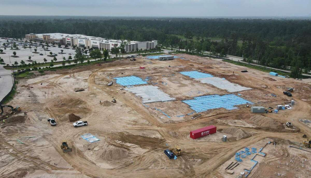 Construction continues at Grand Central Park's multi-purpose community, Wednesday, June 9, 2021, in Conroe.