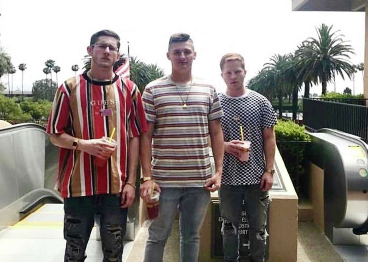 """Austin Hawk, center, with friends Bryce Armstrong, left, and Brent Grijalva, near Chino, Calif., in 2018. """"The bois,"""" as the friends called themselves, dreamed of co-founding a tech company."""