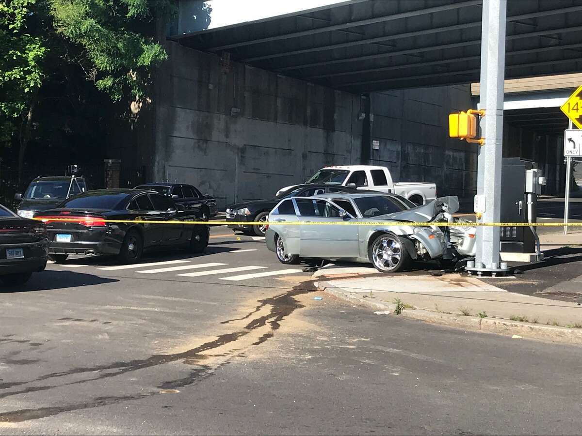 The scene at Main and Catherine streets in Bridgeport, Conn., after a city police officer assigned to a federal task force shot an individual on Tuesday, June 15, 2021. Law enforcement remained at the scene investigating on Wednesday.