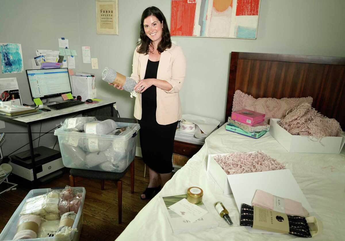 Serena Houlihan, co-founder of Le Wren, prepares to pack a gift box Wednesday, June 16, 2021 in Houston. Le Wren was created by two women, in honor of their mothers' battles with cancer. She is currently using her guest room until Le Wren moves into a larger space this summer.