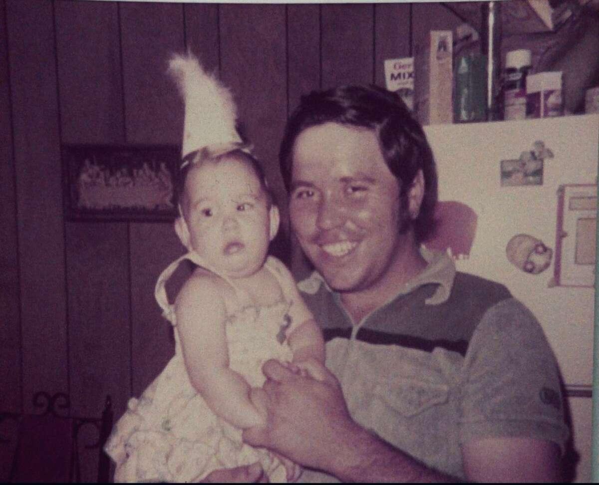 Dad celebrating my first birthday.