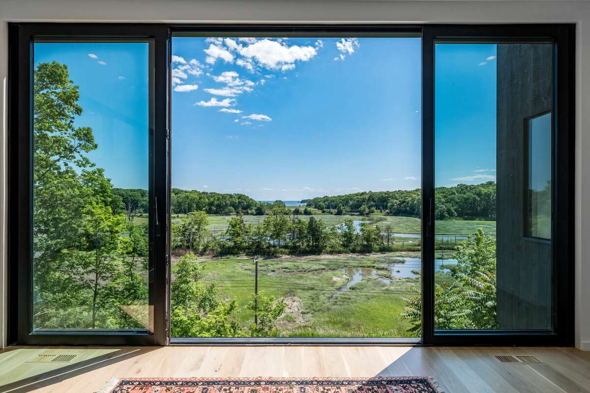 The home has direct views of a salt marsh, Jarvis Creek, the Thimble Islands and Long Island Sound.