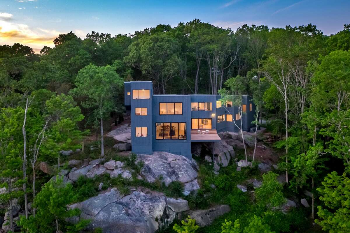 The Leetes Island Road homewas built on a granite promontory and has direct views of a salt marsh, Jarvis Creek, the Thimble Islands and Long Island Sound.