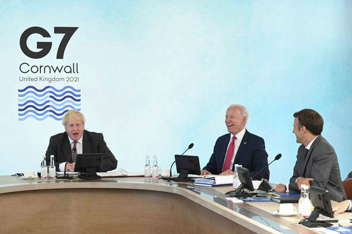 President Joe Biden struck a new, and welcome, tone at the recent G7 summit. Here, he shares a laugh with Britain's Prime Minister Boris Johnson, left, and French President Emmanuel Macron, right.