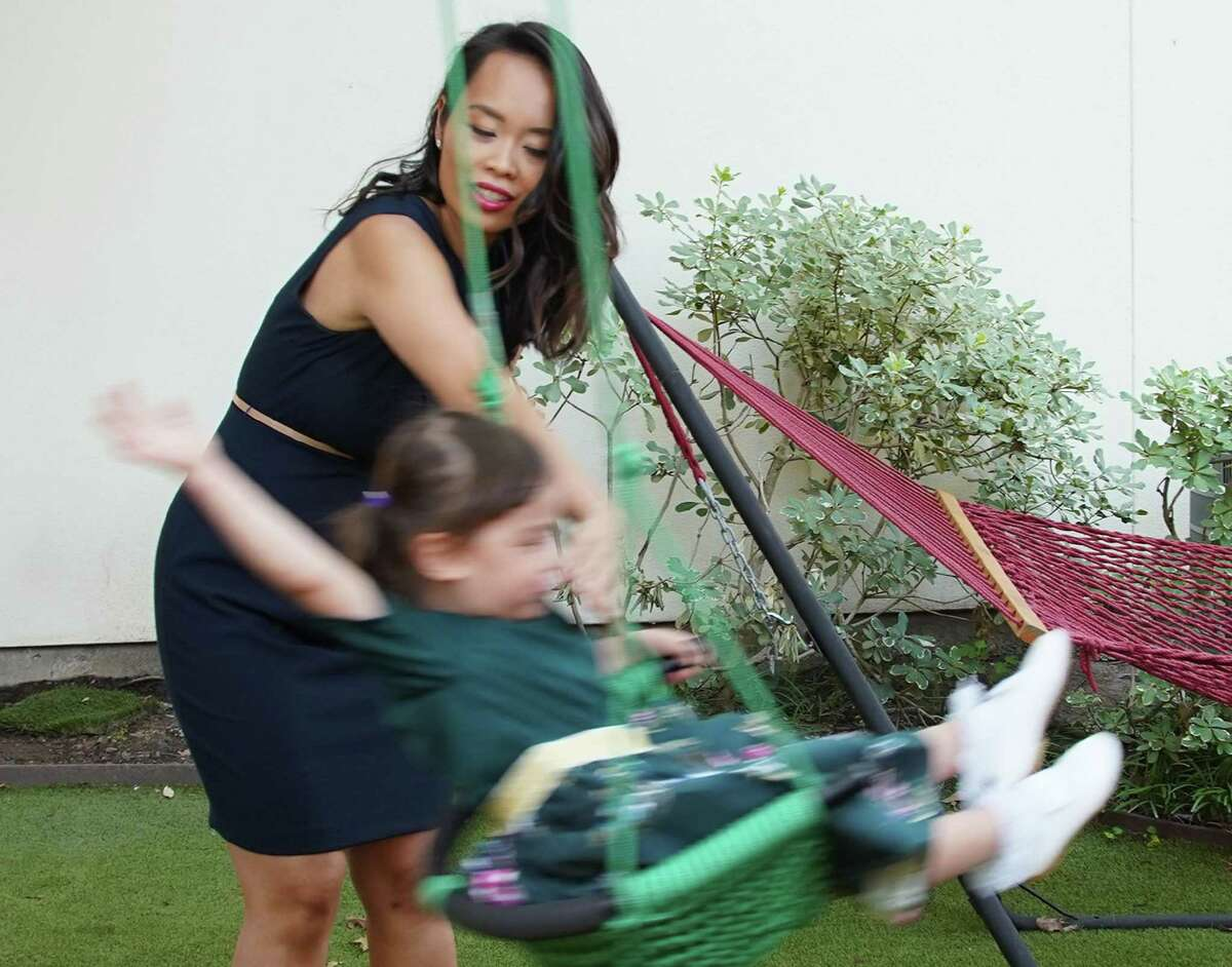 Dr. Anh Nguyen pushes her daughter Kennedy, 3, in her swing at their home in Houston on Thursday, June 17, 2021. Dr Nguyen, who is an ER doctor at Houston Methodist, faced burnout for the first time in her medical career during the pandemic.