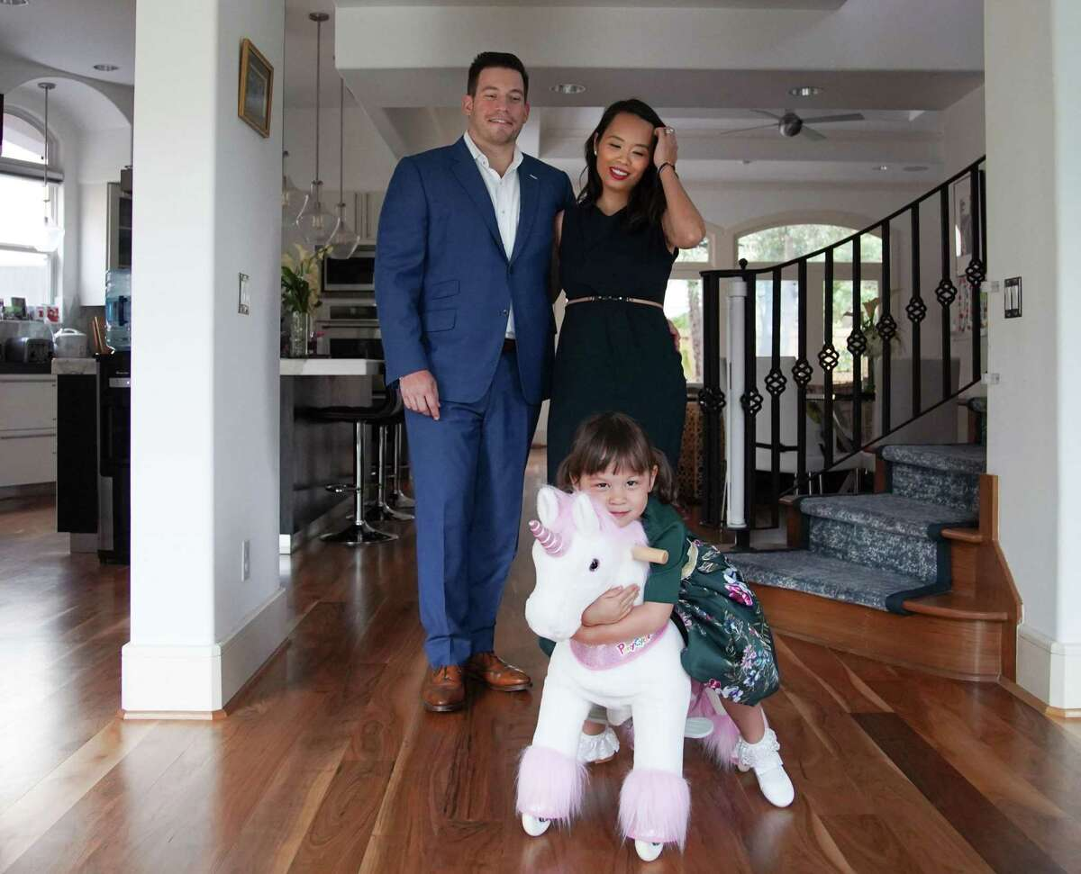 Dr. Anh Nguyen and her husband, Scott Sporn and daughter Kennedy, 3, in their home in Houston on Thursday, June 17, 2021. Dr Nguyen, who is an ER doctor at Houston Methodist, faced burnout for the first time in her medical career during the pandemic.