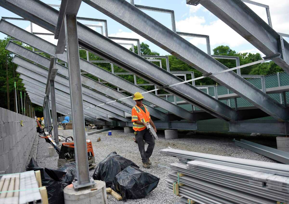 A worker builds new bleachers at Greenwich High School in Greenwich, Conn. Construction has seen the biggest rebound in employment of any major industry in Connecticut, according to updated figures this week from the Connecticut Department of Labor breaking out unemployment claims by varying sectors.