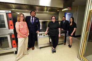 Feed Albany founders and staff; Christine OÕNeil, volunteer coordinator, left, Dominick Purnomo, co-founder, Shannon Dowen-Ronda, chef, Matthew T. Peter, president and co-founder, and Francesca Pardi, executive director, right, are pictured in the kitchen at the organization's new kitchen and headquarters on Friday, June 18, 2021, on Sheridan Avenue in Albany, N.Y.  (Will Waldron/Times Union)