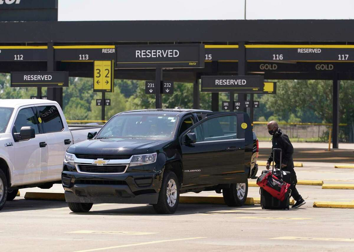 A person gets into a vehicle at Hertz, 8100 Monroe Road, at Hobby Airport Friday, June 18, 2021 in Houston.