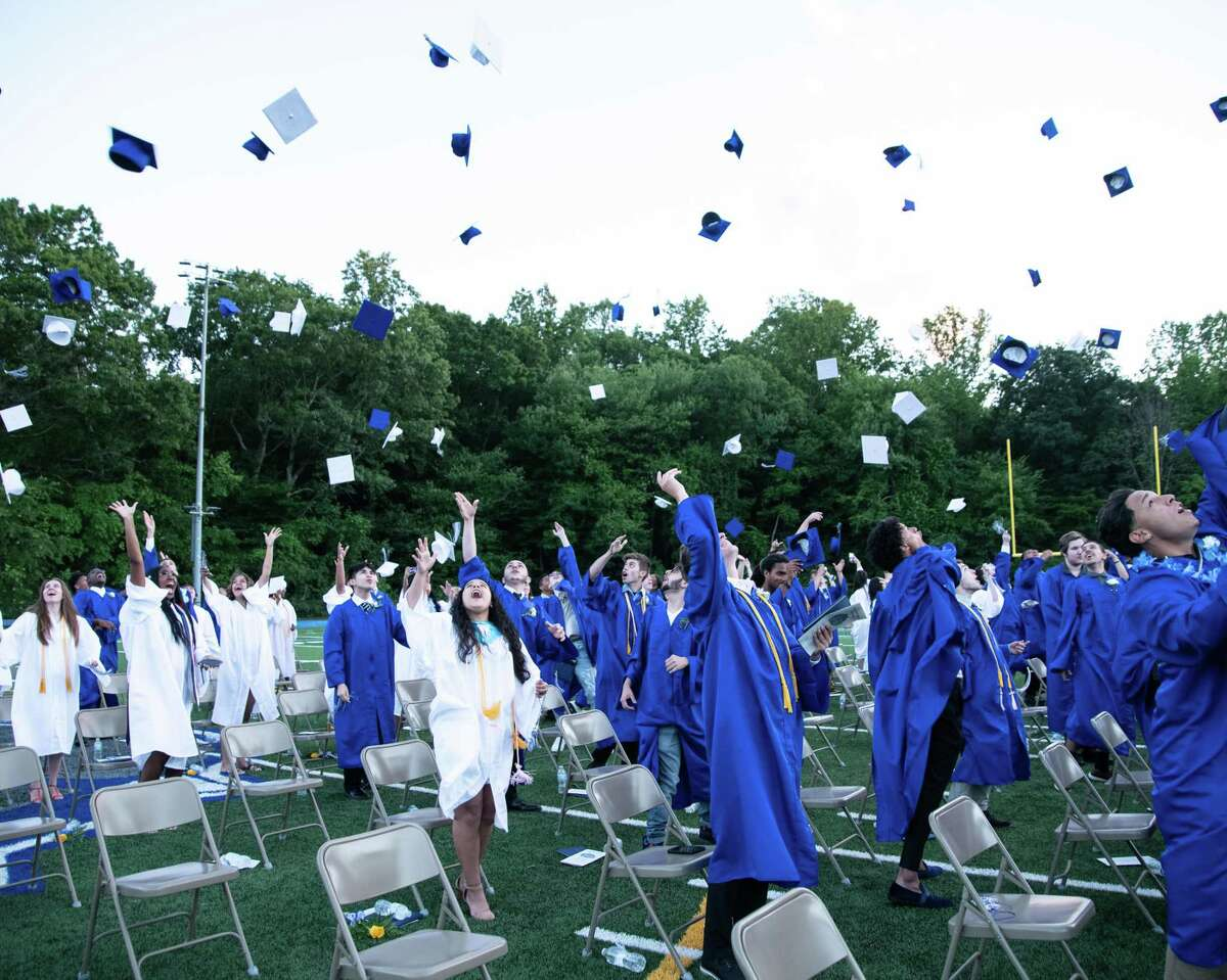 Members of Bunnell High School's Class of 2021 toss their caps at the end of commencement ceremonies June 16, 2021.