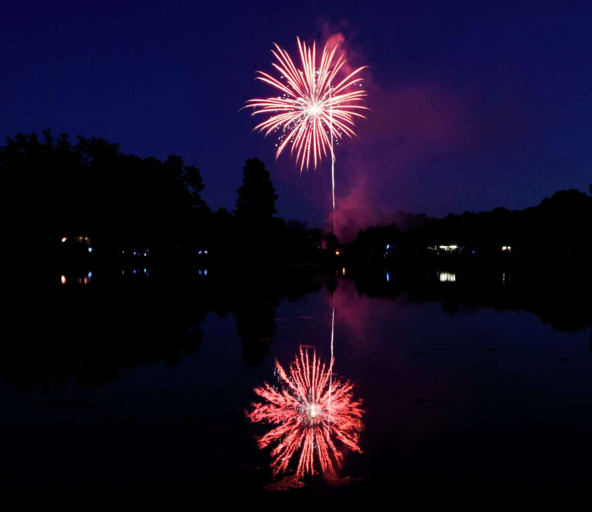 A colorful array of fireworks are displayed at Binney Park in Old Greenwich, Conn. Saturday, July 7, 2018. When the shows return this year to Greenwich Point on July 3 and July 5, the Parks and Recreation Foundation is selling catered picnic dinners as a fundraiser.