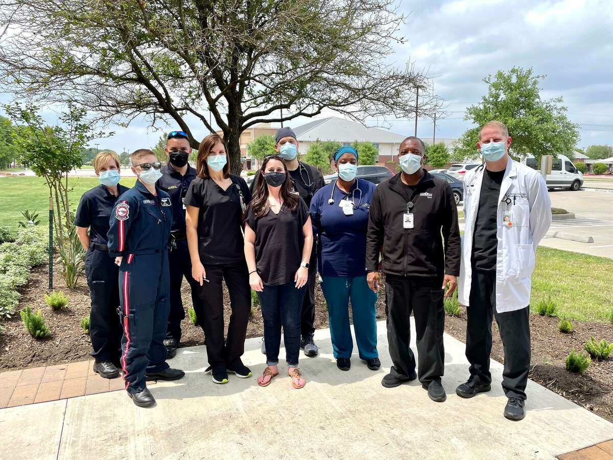 Marissa Miller (center) stands with the doctors and EMT staff that helped her after her stroke.