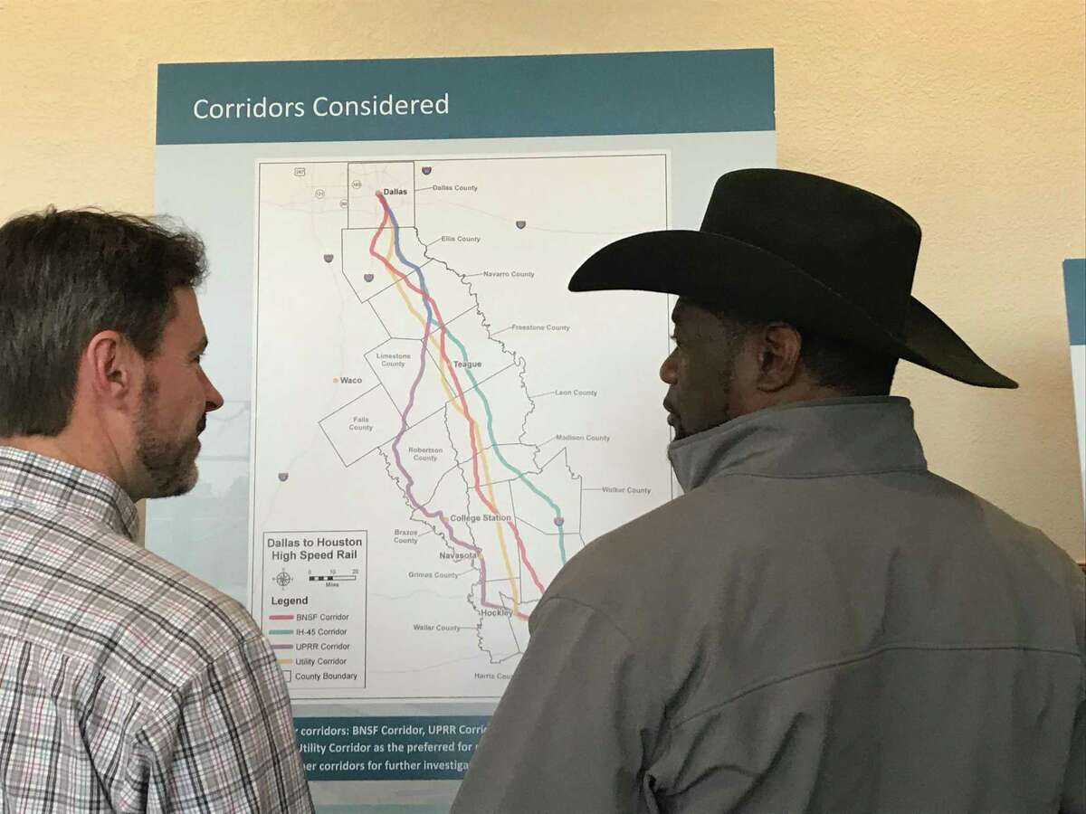 Freestone County Commissioner Michael Daniels, right, talks to a concerned landowner at a public hearing Jan. 31, 2018, in Fairfield as they look over the proposed route of a high-speed rail line by Texas Central Partners.
