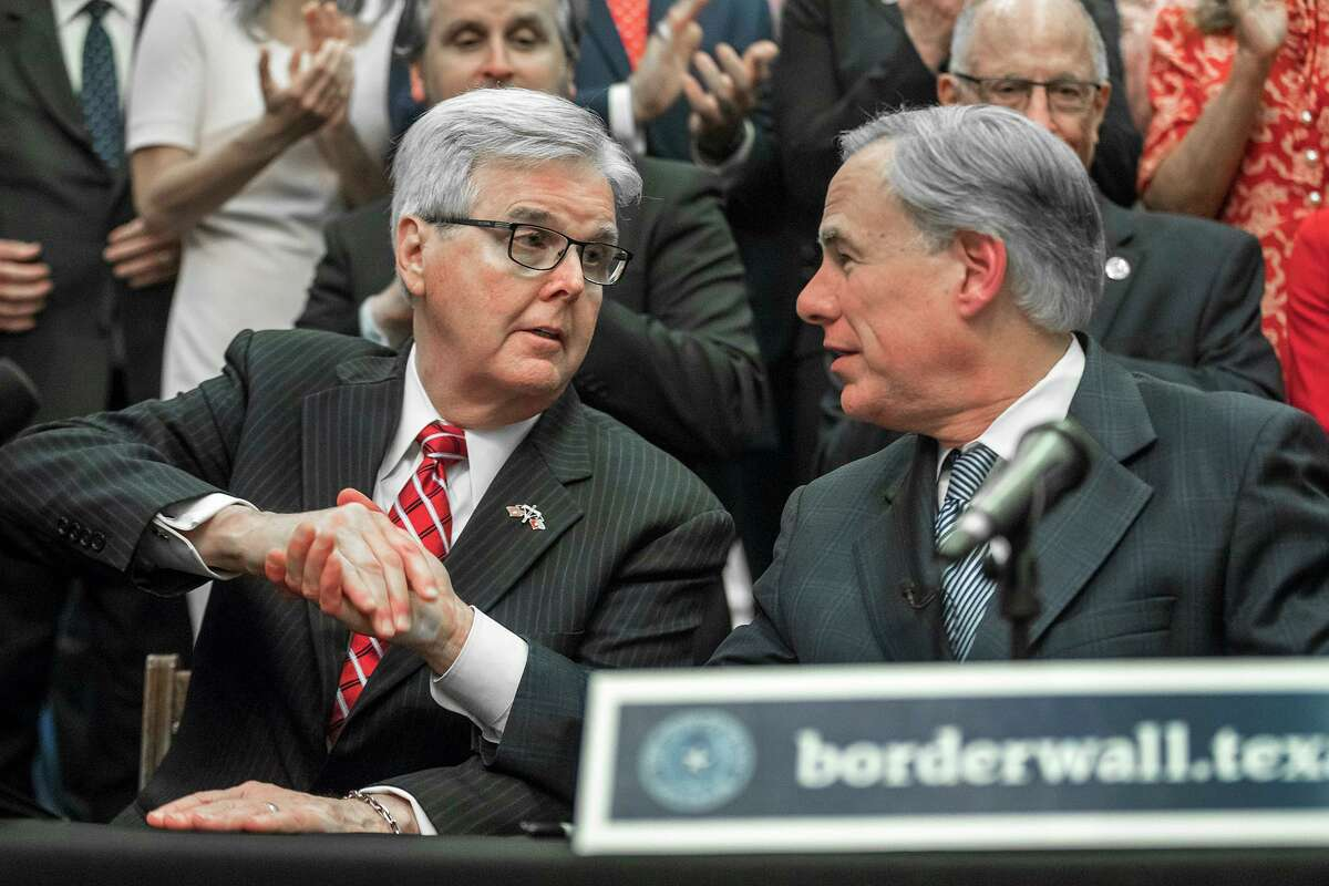 """Lieutenant Gov. Dan Patrick, left, shakes hands with Gov. Greg Abbott during a press conference on details of his plan for Texas to build a border wall and provide $250 million in state funds as a """"down payment."""", Wednesday, June 16, 2021 in Austin, Texas."""