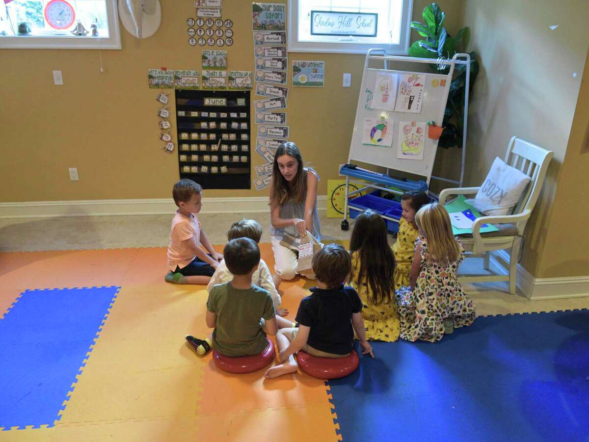 Teacher Jordan Roth works with her students. Several families in Ridgefield decided to form a pod this past year for their kindergartners instead of sending them to school. They hired Roth and held class in one of their homes. Wednesday, June 16, 2021, in Ridgefield, Conn.