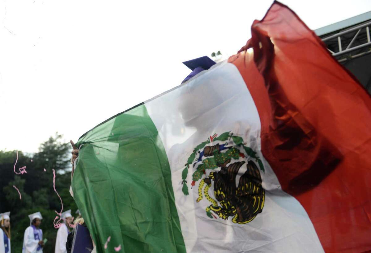 Students across the nation have been crossing the podium with the Mexican flag. That hasn't sat well with some dads.
