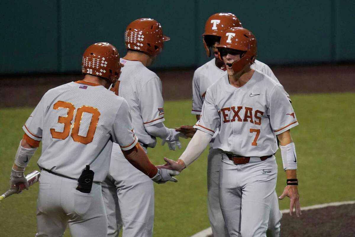 Douglas Hodo III (7), after scoring against South Florida in the Super Regional, is seeking a CWS title to match the 1983 championship won by a Texas team that included his father.