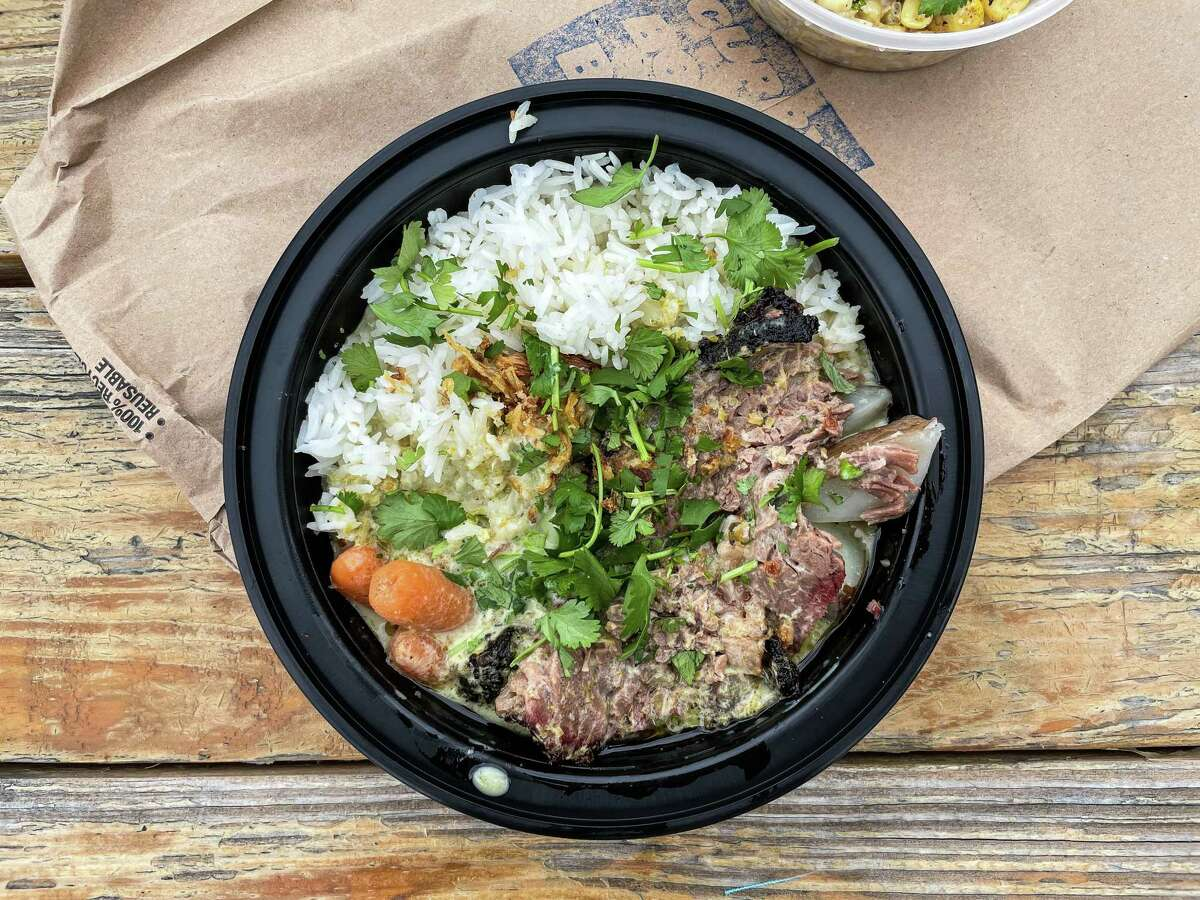 The smoked brisket with green curry is a staple at Curry Boys BBQ in San Antonio.