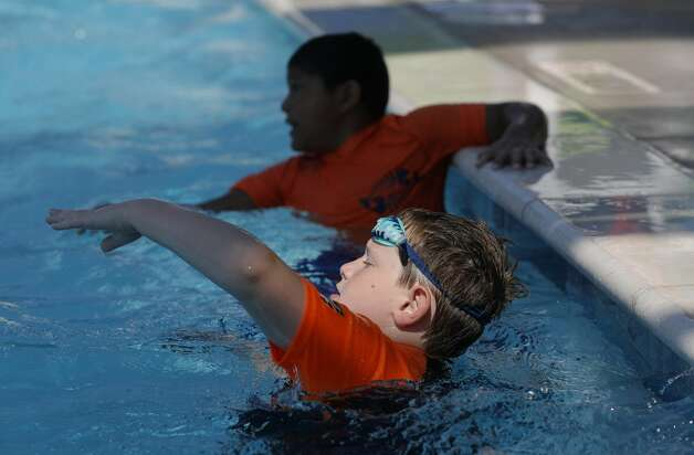 Matthew Vanderveek practices getting his arms out of the water as more than 100 youth from around Montgomery County take part in this year's World's Largest Swimming Lesson at the City of Conroe Water Park, Friday, June 18, 2021, in Conroe. The WLSL event occurs once a year where participating groups take part in the same swim lesson across 48 countries. Since beginning in 2010, the event has reached 320,000 people and serves as a platform to help the global aquatics industry work together to build awareness about the fundamental importance of teaching children to swim to prevent drowning. Photo: Jason Fochtman/Staff Photographer / 2021 © Houston Chronicle